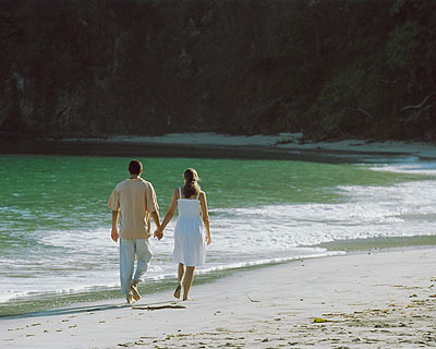 Couple walk on the beach on the Papagayo Peninsula.