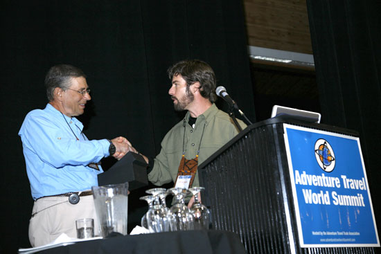 Michael Kaye receives an award from ATTA.