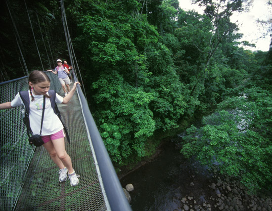 Crossing a hanging bridge in Arenal, Costa Rica.