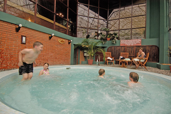 Children enjoy jacuzzi at Monteverde Lodge in Costa Rica.