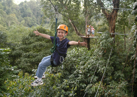 Child on a canopy tour cable at Manuel Antonio in Costa Rica.