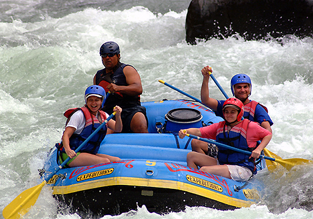 Group rafting tour on the Pacuare River in Costa Rica.