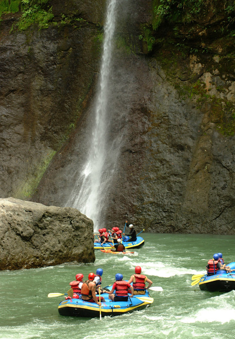 Rafting under Huacas Falls on the Pacuare River in Costa Rica.